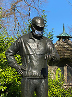 New York City, New York, Coronavirus in New York. A statue of Fred Lebow, founder of the New York Marathon, wears a recommnded  facemask due to the Coronavirus. 4/8/20