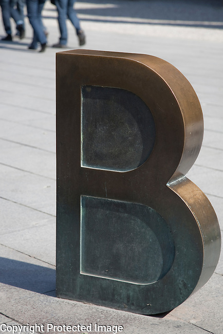 First Letter of the Barcino Sculpture by Joan Brossa in Placa Nova Square in Barcelona, Catalonia, Spain