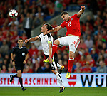 Sam Vokes of Wales tussles with Julian Baumgartlinger of Austria during the World Cup Qualifying Group D match at the Cardiff City Stadium, Cardiff. Picture date 2nd September 2017. Picture credit should read: Simon Bellis/Sportimage