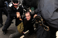 A demonstrator is arrested at the Climate Camp as thousands of protestors descended on the City of London ahead of the G20 summit of world leaders to express anger at the economic crisis, which many blame on the excesses of capitalism.