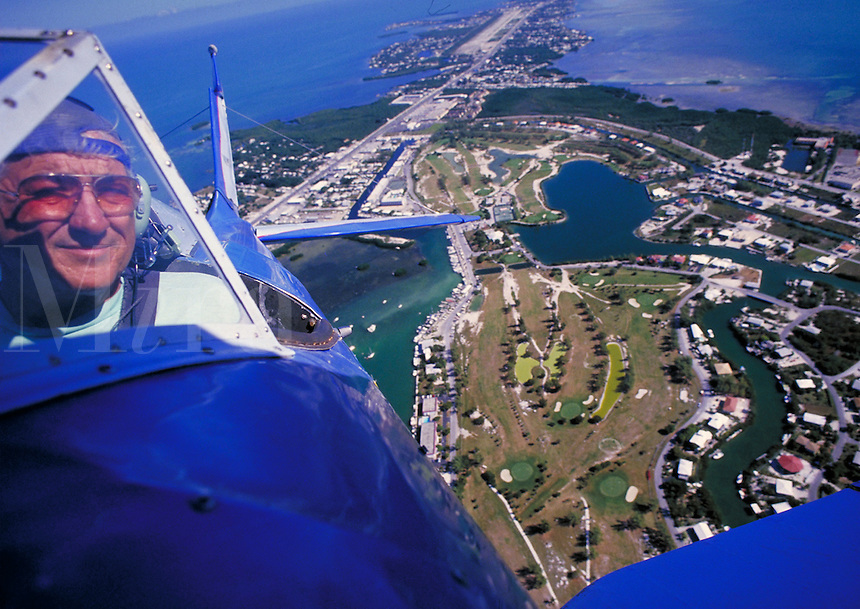 Senior male pilots plane over the Florida Keys. Hobbie. Leisure. Florida Keys Florida.