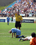 Referee Terry Vaughn shows the red card to Nancy Augustyniak (25) at Torero Stadium in San Diego, CA on 8/24/03 during the WUSA's Founders Cup III between the Atlanta Beat and Washington Freedom. The Freedom won 2-1 in overtime.