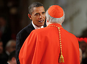 Boston, MA - August 29, 2009 -- President Barack Obama talks with Cardinal Sean O?Malley, Archbishop of Boston. during funeral services for U.S. Senator Edward Kennedy at the Basilica of Our Lady of  Perpetual Help in Boston, Massachusetts August 29, 2009.  Senator Kennedy died late Tuesday after a battle with cancer.    .Credit: Brian Snyder- Pool via CNP
