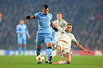 Vasili Berezutski of CSKA gets in a last minute challenge on Sergio Aguero of Manchester City - Manchester City vs. CSKA Moscow - UEFA Champions League - Etihad Stadium - Manchester - 05/11/2014 Pic Philip Oldham/Sportimage