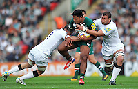 Manu Tuilagi is double-tackled. Aviva Premiership match, between Leicester Tigers and Newcastle Falcons on September 21, 2013 at Welford Road in Leicester, England. Photo by: Patrick Khachfe / JMP