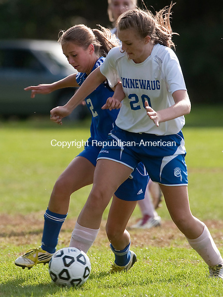 WOODBURY, CT -01 OCTOBER 2012--000112JS06-Nonnewaug's Brynn Lawlor and Lewis Mills'  Hope Sherman (12) battle for the ball during their game Monday at Nonnewaug High School in Woodbury. .Jim Shannon Republican-American
