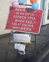 Pictured: Balloons and Happy Birthday wishes on a sign for a roundabout which hasn't been beuilt for over a year in Ammanford, Carmarthershire, Wales, UK. STOCK PICTURE<br /> Re: Pranksters have celebrated the first birthday of the non-existent roundabout in Ammanford, west Wales.<br /> Work to build the roundabout on the junction of Wind Street and Tirydail Lane began in February 2018 and is still causing disruption in the town.<br /> Residents have been left frustrated with the length of time it has taken to complete the road works.<br /> The frustration has led an unknown individual to stick balloons and birthday banners to signs and corns surrounding the construction area.<br /> A Facebook post featuring images of the decorated site has been shared by hundreds of users.