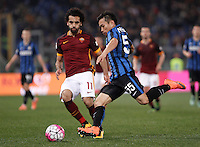 Calcio, Serie A: Roma vs Inter. Roma, stadio Olimpico, 19 marzo 2016.<br /> FC Inter&rsquo;s Yuto Nagatomo, left, is challenged by Roma&rsquo;s Mohamed Salah during the Italian Serie A football match between Roma and FC Inter at Rome's Olympic stadium, 19 March 2016. The game ended 1-1.<br /> UPDATE IMAGES PRESS/Isabella Bonotto