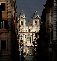 Low angle view of the church of the Santissima Trinita dei Monti, Rome, Italy, pictured between the houses of the approaching street, on December 11, 2010 in the afternoon. Trinita dei Monti, 16th century, a late Renaissance church, is located at the top of the Spanish Steps which lead into the Piazza di Spagna. In front of the church stands the Sallustiano obelisk, a Roman obelisk built during the reign of Emperor Aurelian, reigned 270-75. Picture by Manuel Cohen