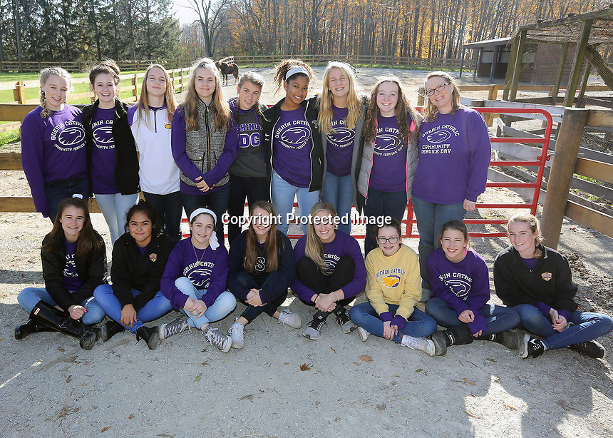 Students with Jenny Greene and Kelly Ann Janssen pose for a group photo before leaving Agape Therapeutic Horseback Riding near Cicero.