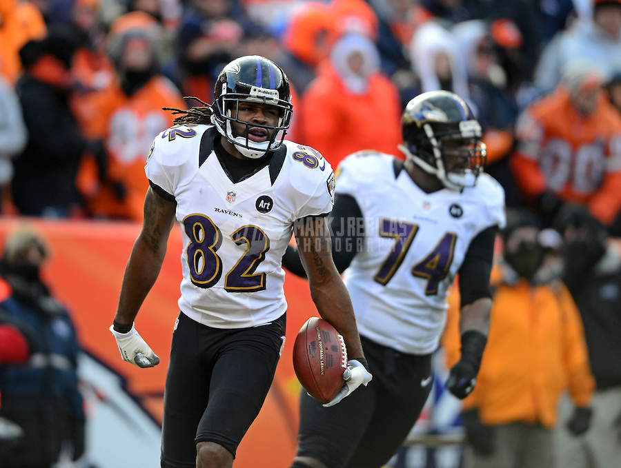 Jan 12, 2013; Denver, CO, USA; Baltimore Ravens wide receiver Torrey Smith (82) celebrates a touchdown against the Denver Broncos in the first quarter during the AFC divisional round playoff game at Sports Authority Field.  Mandatory Credit: Mark J. Rebilas-