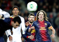 FC Barcelona's Carles Puyol (r) and Real Madrid's Raphael Varane during Copa del Rey - King's Cup semifinal second match.February 26,2013. (ALTERPHOTOS/Acero) /Nortephoto