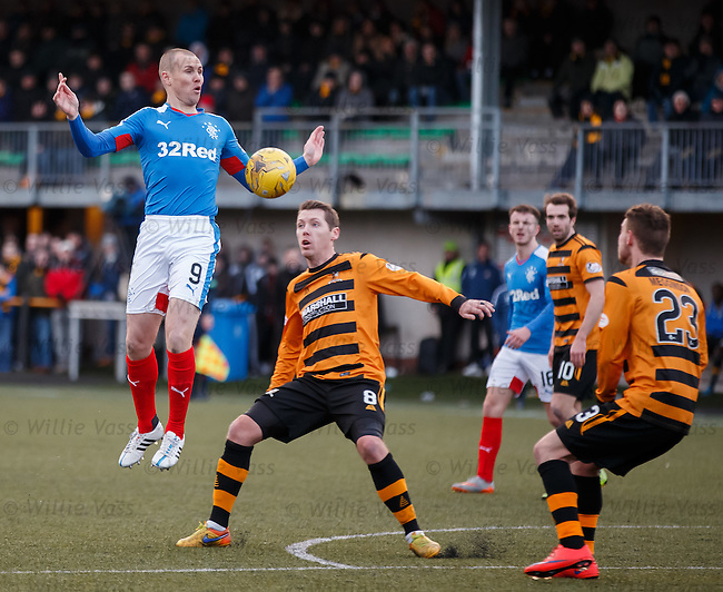 Kenny Miller towers over Burton O'Brien