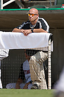Kannapolis Intimidators trainer Chris McKenna takes in the action from the top step of the dugout at Fieldcrest Cannon Stadium in Kannapolis, NC, Monday, September 3, 2007.