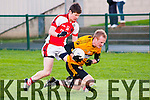 Listowel V Rathmore : Listowwel Emmetts Fergus Reen wins the ball from Rathmore's John Moynihan in the Listowel Emmetts V Rathmore Division 1 league game in Listowel on Sunday last.