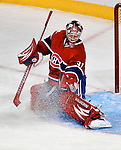 15 October 2009: Montreal Canadiens goaltender Carey Price makes a third period save against the Colorado Avalanche at the Bell Centre in Montreal, Quebec, Canada. The Avalanche defeated the Canadiens 3-2 in the home opening game for the Habs. Mandatory Credit: Ed Wolfstein Photo