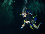 Chandelier Cave, Palau -- Diver swimming through the underwater cave system.