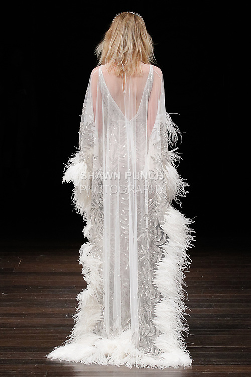 """Model walks runway in a """"Mogador"""" bridal gown from the Naeem Khan Bridal Spring 2018 collection, on April 21, 2017; during New York Bridal Fashion Week."""