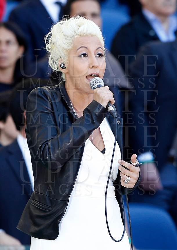 Calcio, finale di Coppa Italia: Roma vs Lazio. Roma, stadio Olimpico, 26 maggio 2013..Italian singer-songwriter Malika Ayane sings the national anthem prior to the start of the Italian Cup football final match between AS Roma and Lazio at Rome's Olympic stadium, 26 May 2013..UPDATE IMAGES PRESS/Isabella Bonotto....
