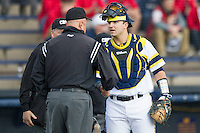 Michigan Wolverines catcher Harrison Wenson (7) shakes the hand of an umpire before the game against the Eastern Michigan Hurons on May 3, 2016 at Ray Fisher Stadium in Ann Arbor, Michigan. Michigan defeated Eastern Michigan 12-4. (Andrew Woolley/Four Seam Images)