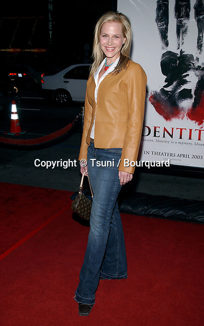 """Julie Benz arriving at the Premiere of """" Identity """" at the Grauman Chinese Theatre in Los Angeles. April 23, 2003."""