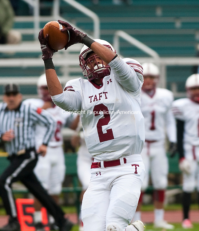WATERTOWN, CT--- -100215JS09---Taft's Alex Salytchev (2) catches a pass he would run in for a touchdown during their game against Brunswick Saturday at the Taft School in Watertown.<br /> Jim Shannon Republican-American