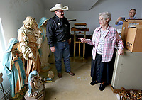 NWA Democrat-Gazette/DAVID GOTTSCHALK Sister Regina Schroeder (right), speaks with Dennis Huggins, owner and auctioneer of Border Town Auctions, discuss statues Thursday, May 9, 2019, for the upcoming auction of items from St. Scholastica Monastery in Fort Smith. The nuns of St. Scholastica Monastery moved in January from their very large almost century-old building into a smaller convent. They are selling hundreds of items at auction beginning Thursday.