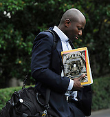 Washington, DC - September 12, 2009 -- Reggie Love, special assistant and personal aide to U.S. President Barack Obama, walks out of the White House toward Marine One on the South Lawn in Washington on September 12, 2009. President Obama is traveling to Minneapolis, Minnesota to speak at a rally on health insurance reform.  .Credit: Alexis C. Glenn / Pool via CNP