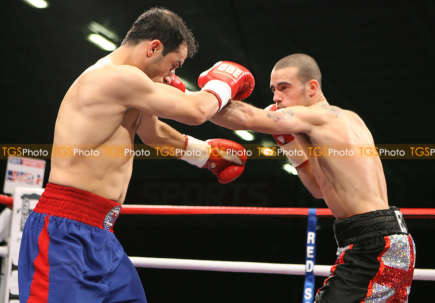 Rick Godding (black/red shorts) defeats Youssef Al Hamidi in a Light-Welterweight Boxing contest at the Bolton Arena, promoted by Frank Maloney - 23/10/09 - MANDATORY CREDIT: Chris Royle/TGSPHOTO - Self billing applies where appropriate - Tel: 0845 094 6026.