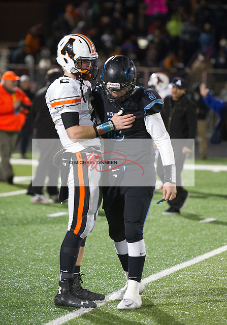West quarterback PJ Seui consoles Ben Stewart following the game.  Photo for the Star by Michael Dinneen