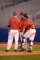 Ball State Cardinals head coach Rich Maloney (2) talks with starting pitcher Zach Plesac (11) and catcher Jarett Rindfleisch during a game against the Wisconsin-Milwaukee Panthers on February 26, 2016 at Chain of Lakes Stadium in Winter Haven, Florida.  Ball State defeated Wisconsin-Milwaukee 11-5.  (Mike Janes/Four Seam Images)