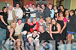 KEY TO THE DOOR: Christopher O'Regan, Ballinorig (seated 4th left), who celebrated his 21st birthday with a large crowd of family and friends in the Slieve Mish Bar on Saturday night.   Copyright Kerry's Eye 2008