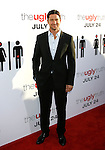 """HOLLYWOOD, CA. - July 16: Gerard Butler arrives at the Los Angeles premiere of """"The Ugly Truth"""" held at the Pacific's Cinerama Dome on July 16, 2009 in Hollywood, California."""