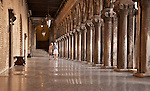 Two women walk the halls of the Doge's Palace in Venice, Italy