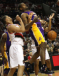 04/08/11-- Lakers' Ron Artest loses control of the ball in Portland's 93-86 win over L.A. at the Rose Garden..Photo by Jaime Valdez........................................