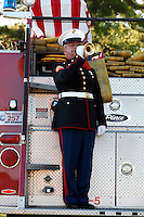 Cpl. Bob Francis of the Corporal Mason O. Yarbrough Detachment of the Marine Corps League plays the bugle during the closing ceremony of Saturday's vigil in remembrance of Sept. 11, 2001. The vigil was held at Freedom Corner near Capaha Park in Cape Girardeau, Missouri.