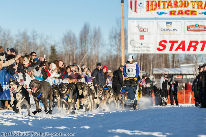 Katherine Keith blasts out off the start line during the restart in Willow, Alaska.  Iditarod Sled Dog Race 2014<br /> <br /> PHOTO (c) BY JEFF SCHULTZ/IditarodPhotos.com -- REPRODUCTION PROHIBITED WITHOUT PERMISSION
