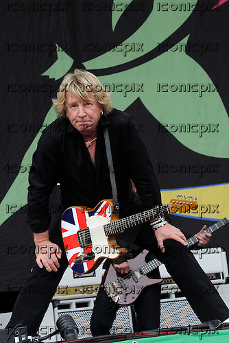 Status Quo - guitarist Rick Parfitt performing live on Day 3 on the Pyramid Stage at the 2009 Glastonbury Festival Pilton Somerset UK - 28 Jun 2009.  Photo by: George Chin / IconicPix