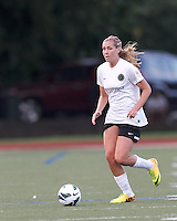 Portland Thorns FC midfielder Allie Long (10) brings the ball forward.  In a National Women's Soccer League (NWSL) match, Boston Breakers (blue) defeated Portland Thorns FC (white/black), 2-1, at Dilboy Stadium on August 7, 2013.