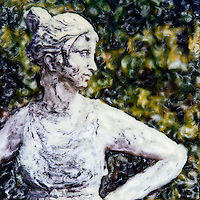 The garden &quot;queen&quot; rules her garden and watches over her plants and flowers keeping them safe.<br />