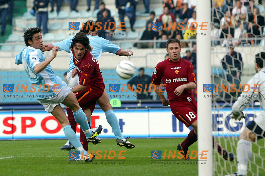 Roma 21/4/2004 Campionato Italiano Serie A <br /> Lazio - Roma 1-1 <br /> Colpo di testa di Gaetano D'Agostino (Roma)<br /> An head shot of Gaetano D'Agostino (Roma)<br /> Lazio and Roma are playing again after it was suspended on March 21, 2004, for security reasons.  <br /> Foto Andrea Staccioli Insidefoto