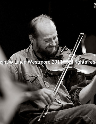 """John Wigg, musician with the """"Edge of Chaos Orchestra"""" recording at the Blue Coconut Club, Pulborough, West Sussex."""