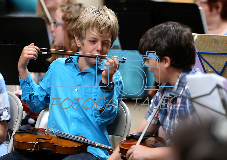 Violinists Jacob Bainton, 12, left, and Nathan Parsons, 11, wait for the start of the Carson City Symphony's Youth Strings Summer Program concert in Carson City, Nev., on Thursday, July 27, 2017. <br />