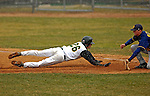 8 April 2007: University of Vermont Catamounts outfielder Nate Matusick, a Sophomore from Corning, NY, dives safely back to first during game action against the New York Institute of Technology Bears at Historic Centennial Field, in Burlington, Vermont. The Bears defeated the Catamounts 3-0 in the first game of a double-header...Mandatory Photo Credit: Ed Wolfstein Photo