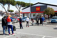 Since last night, long lines have formed out of the supermarkets, due to the restriction that allows few people at a time inside<br /> Rome March 10th 2020. Rome the day after the last Minister Council's decree, that extends the restrictions from North of Italy to the entire country to contain Covid-19 Virus. All the shops (restaurants, pubs, and even supermarkets) will have to close at 6 pm. Gathering of people will be forbitten and people will have to maintain the 1 meter security distance. Citizens are furthermore invited to stay at home with the exception of people who have to go to work, to the pharmacy or to the supermarket.<br /> Photo Samantha Zucchi Insidefoto