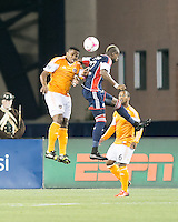 Houston Dynamo defender Jermaine Taylor (4) and New England Revolution forward Dimitry Imbongo Boele (92) compete for a head ball in front of Houston Dynamo defender Mike Chabala (6).  The New England Revolution played to a 1-1 draw against the Houston Dynamo during a Major League Soccer (MLS) match at Gillette Stadium in Foxborough, MA on September 28, 2013.