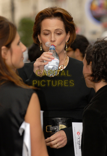 "SIGOURNEY WEAVER.Attending the UK Film Premiere of Disney Pixar's ""Wall-e"" at Empire Cinema Leicester Square, London, England, UK, July 13th 2008..WallE Wall*e Wall.E half length hand drinking water bottle .CAP/IA.©Ian Allis/Capital Pictures"