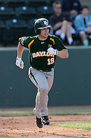 Logan Vick #19 of the Baylor Bears runs to first base against the UCLA Bruins at Jackie Robinson Stadium on February 25, 2012 in Los Angeles,California. UCLA defeated Baylor 9-3.(Larry Goren/Four Seam Images)