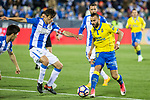 Jese Rodriguez of UD Las Palmas holds off pressure from  Martin Mantovani of Club Deportivo Leganes during the match of La Liga between Deportivo Leganes and Union Deportiva Las Palmas  Butarque Stadium  in Madrid, Spain. April 25, 2017. (ALTERPHOTOS/Rodrigo Jimenez)