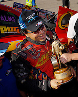 Apr 9, 2006; Las Vegas, NV, USA; NHRA Funny Car driver Cruz Pedregon driver of the Advance Auto Parts Chevrolet Monte Carlo  celebrates after defeating Ron Capps in the final round of Funny Car at the Summitracing.com Nationals at Las Vegas Motor Speedway in Las Vegas, NV. Mandatory Credit: Mark J. Rebilas